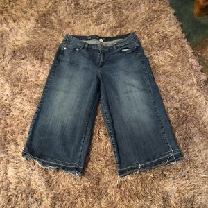 Lane Bryant Capri jeans with tattered hemline.